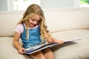 Little-girl-reading-picture-book.jpg