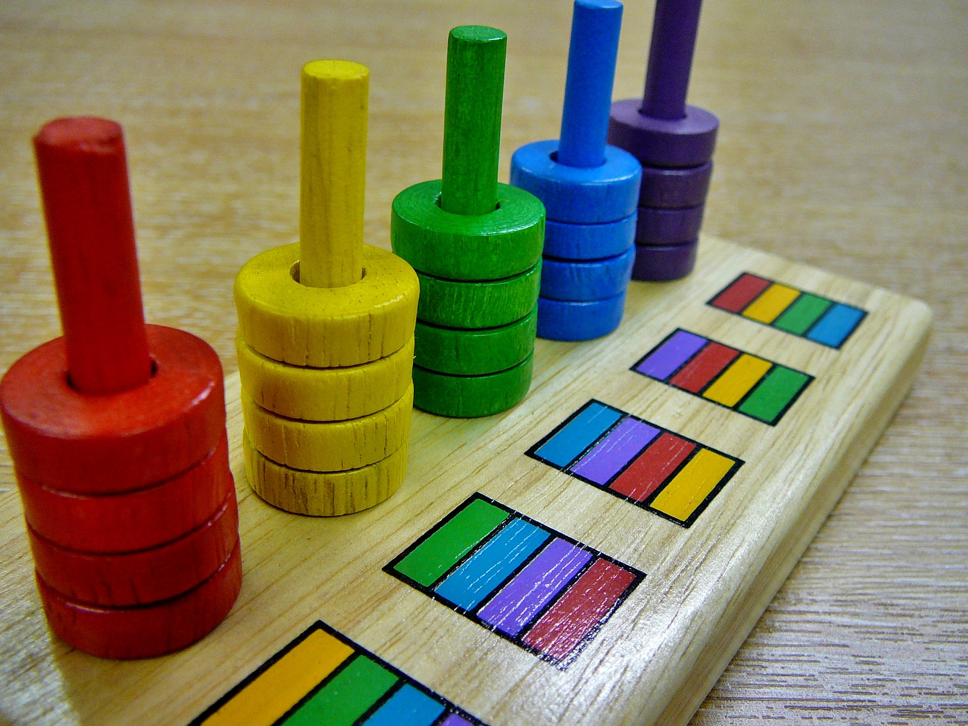 Colored stacking disks logic puzzle