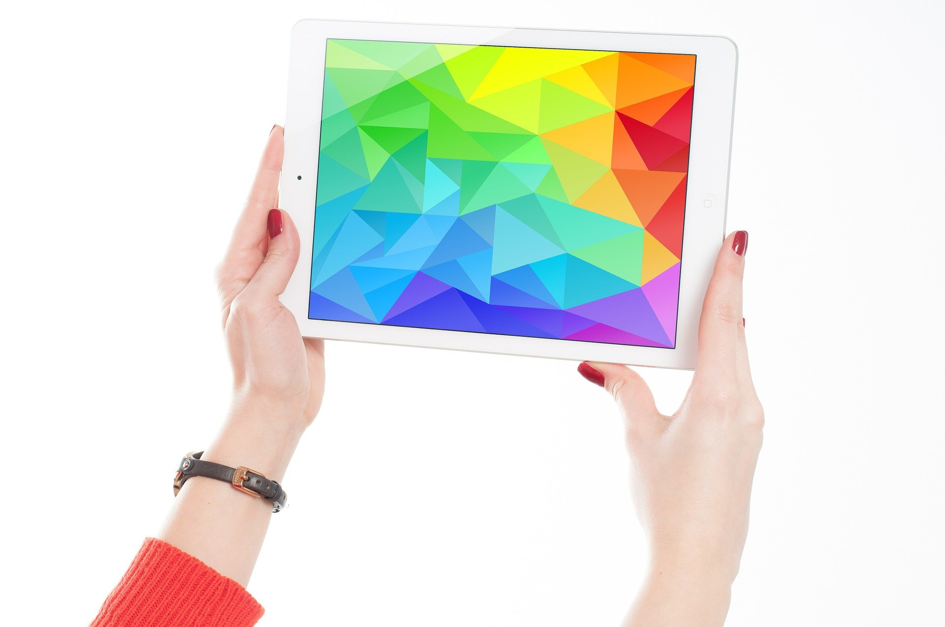 woman holding tablet showing abstract color pattern