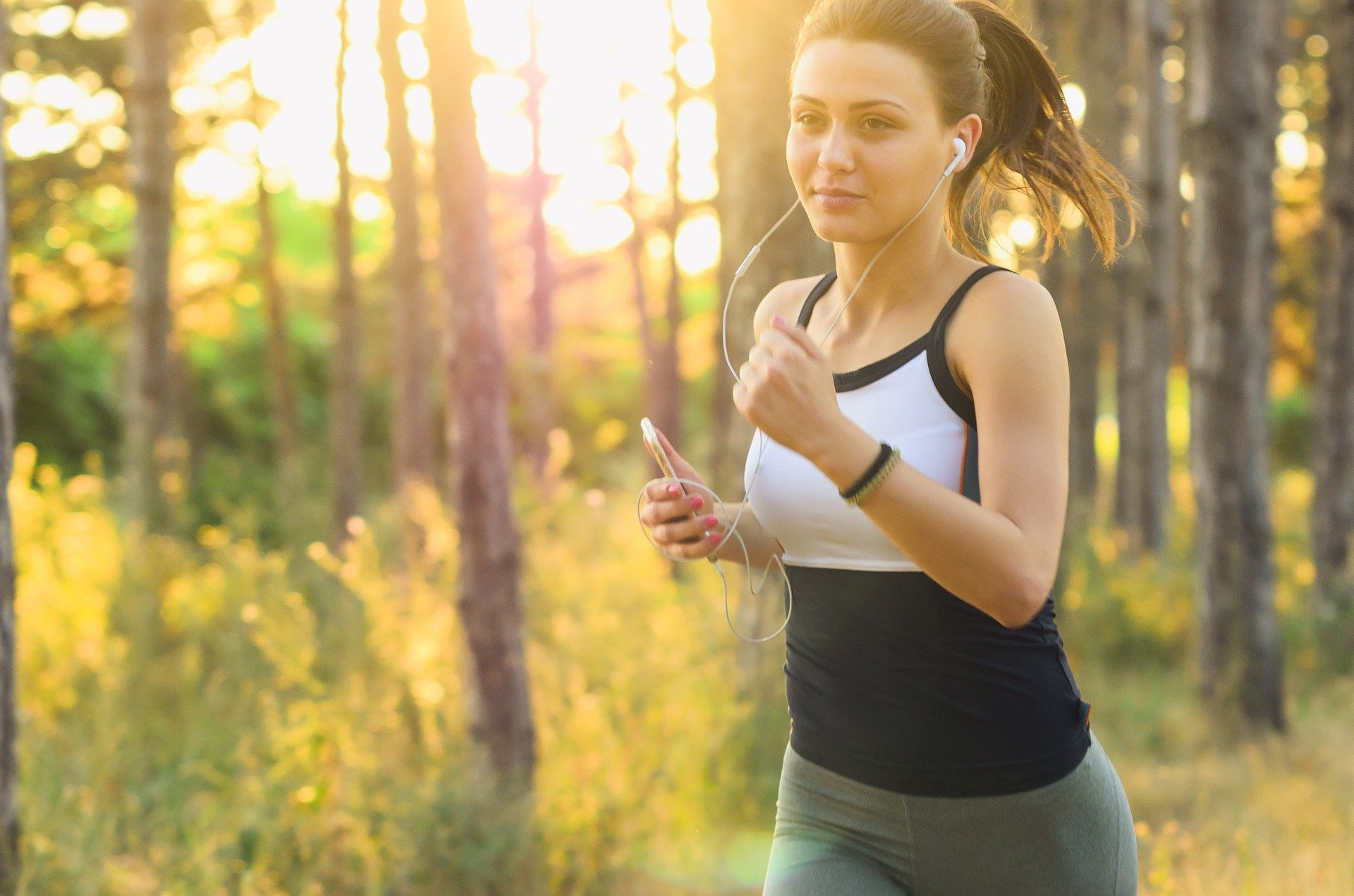 Woman jogging in woods