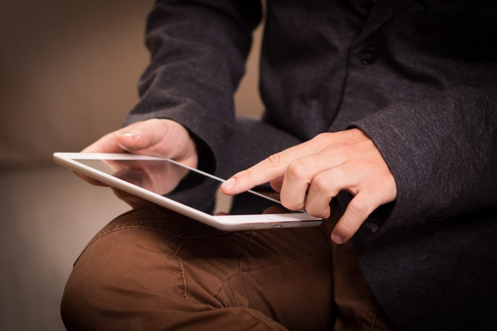 Teen boy playing with tablet