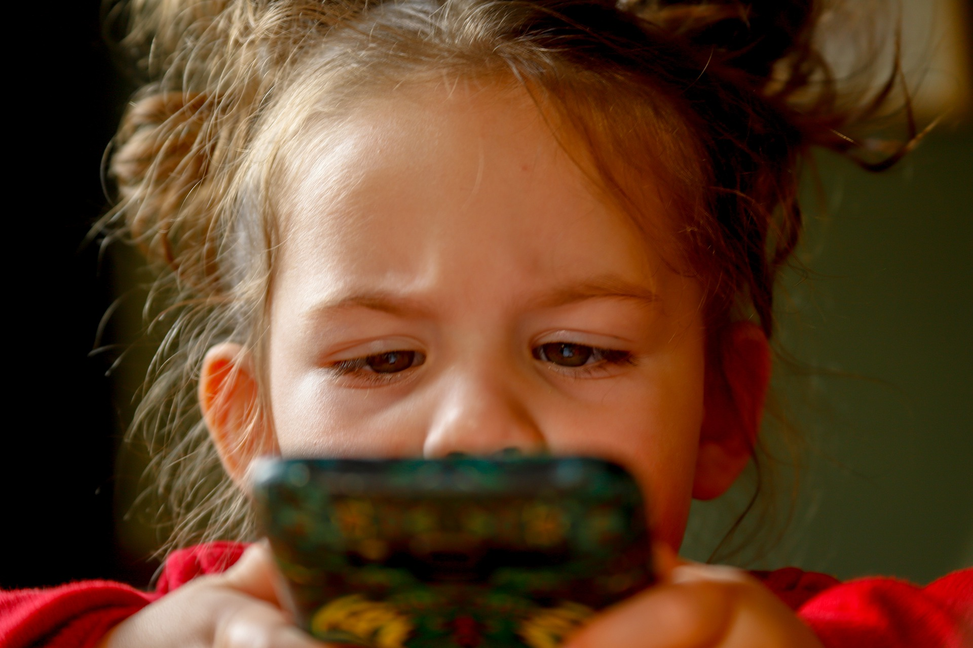 Young girl playing with phone
