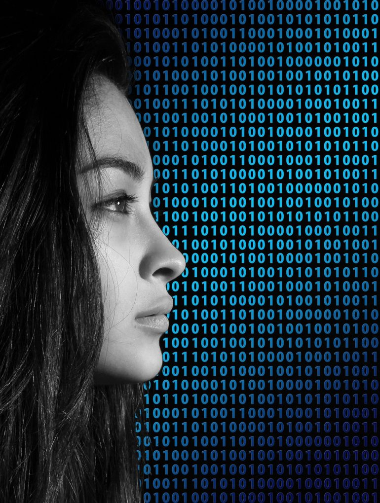 female Silhouette against a background of binary code