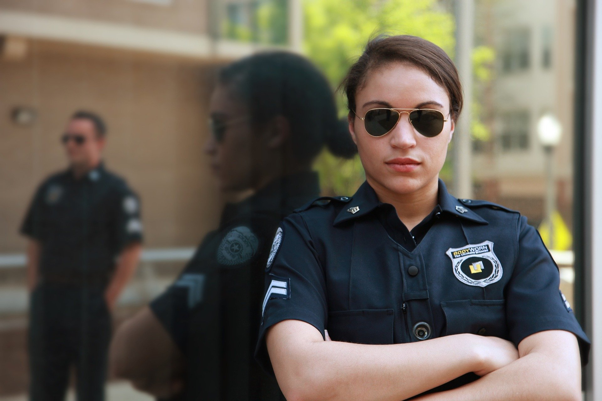 police woman with arms folded